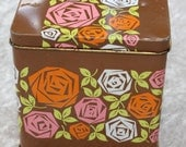 Cute retro 70s brown canister with floral pattern from Great Britain