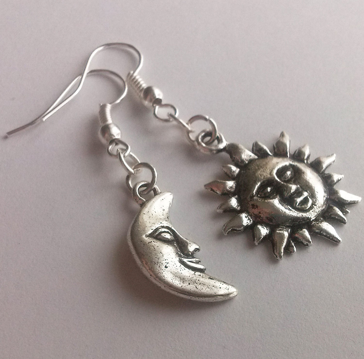 asymmetrical mismatched earrings silver sun and moon smiling