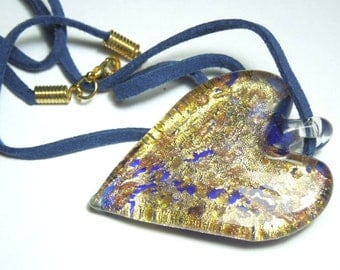 Murano glass pendant with large inky blue and gold heart on blue suede cord.