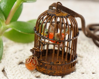 Necklace Rusty Cage with Orange Bird (#4436)