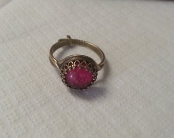 Antique gold ring with red stone