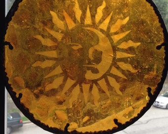 Stained glass panel with etched sun.