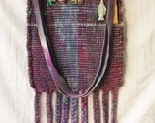 Hand Dyed Handwoven Shoulder Bag with Charms and Glow in the Dark Madonna in Purples with Braided Fringe