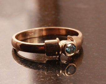 Blue diamond engagement ring in rose gold - More options available.