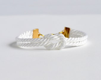 Shiny white forever knot nautical rope bracelet with gold anchor charm