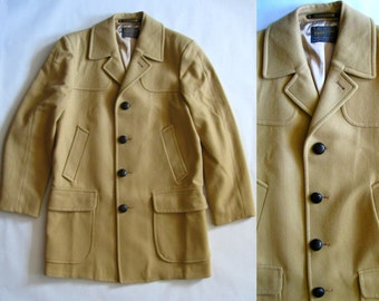 Vintage Pendleton camel wool coat, fully lined, with many pockets, notched collar, and leather woven buttons, medium