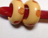 Bakelite polka dot earrings.