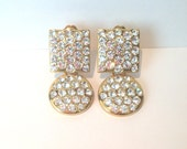 The most fab vintage 80s huge white rhinestone earrings // statement // high fashion // gold