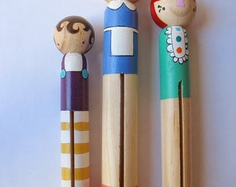 Wooden folk art giant round clothespin dolls... three little girls