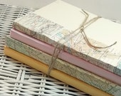 Book bundle wedding centerpiece, Decorative Book Stack tied with twine Pink, Gold reclaimed old books with map for destination wedding