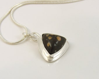 Sterling silver trillion pendant with dark stone