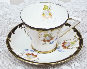 English Bone China Teacup and Saucer Vintage Gladstone White Background with Coral and Blue Floral Piped in Black and Gold