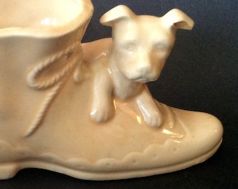 Perfect New Born, Baby Shower, or Housewarming Gift. 1950's, this Planter/Vase features a Puppy hanging over the Toe of a Fashionable Boot