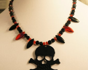 Big Beautiful skull and black and red glass bead necklace