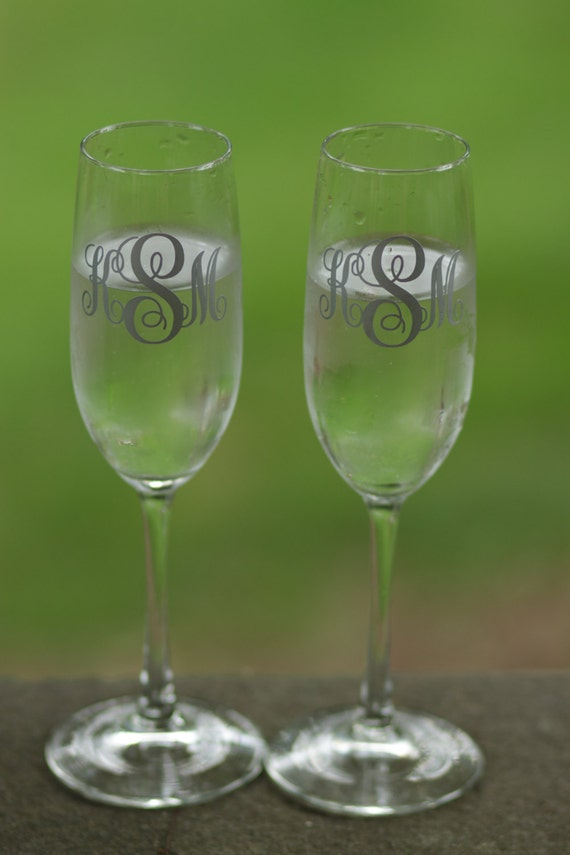 Wedding Present Champagne Glasses : ... Wedding champagne glasses personalized with Monogram. Engagement gift