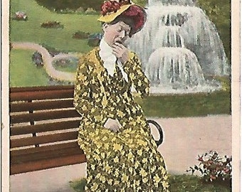 """Antique 1908 Postcard Comic Old Maid """"The Male Is Late!""""  Yellow Floral Dress on Park Bench near Large Fountain"""