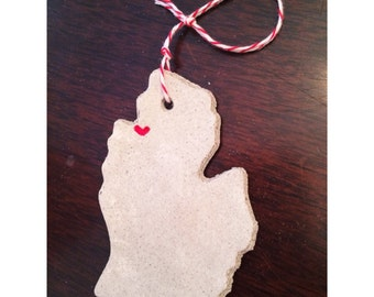 Traverse city, Michigan. Made with Michigan sand, Handmade Ornaments and magnets that capture your heart