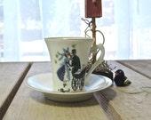 Vintage Raymond Peynet illustrated Limoges porcelain demitasse cup and saucer