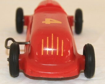 Saunders Wind-up Car - Toy Racecar Red Number 4 - Vintage 1950's