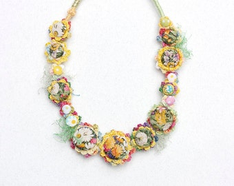 Floral textile necklace, crochet jewelry with fabric buttons, pastel, OOAK