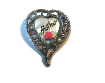 Heart brooch, Mother of Pearl with Mother in enamel and pink rose, embellished with rhinestones and a seed pearl