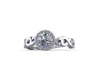 round diamond engagement ring with diamond halo on a scroll pattern gold band