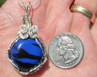 Blue  Resin bead in twisted Silverfilled wire Pendant.