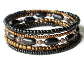 Stacked bead bracelets - beaded copper & black bangles - 5 in one
