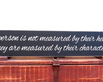 A person is not measured by their height distressed rustic wood sign saying