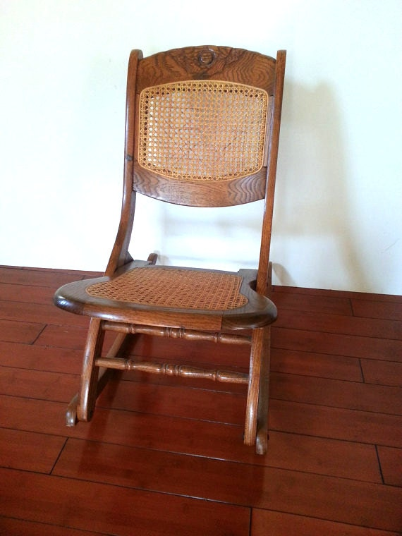 Rocking chair antique carved solid oak folding rocker caned back and