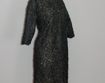 1960s green sparkly shift dress with bracelet length sleeves