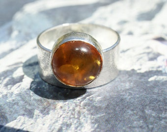 Handmade contemporary sterling silver ring with offset amber stone
