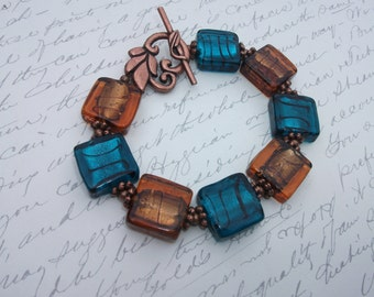 Copper and teal color Murano glass tile bracelet with decorative leaf toggle clasp