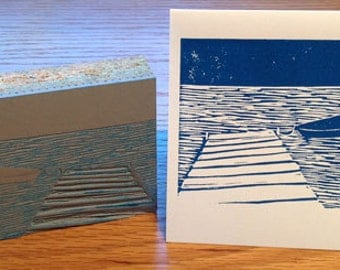 Kayak on lake linocut block print card