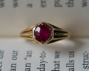 Antique 10k gold ring from the 1930s era.  Set with a deep red, lab grown ruby.
