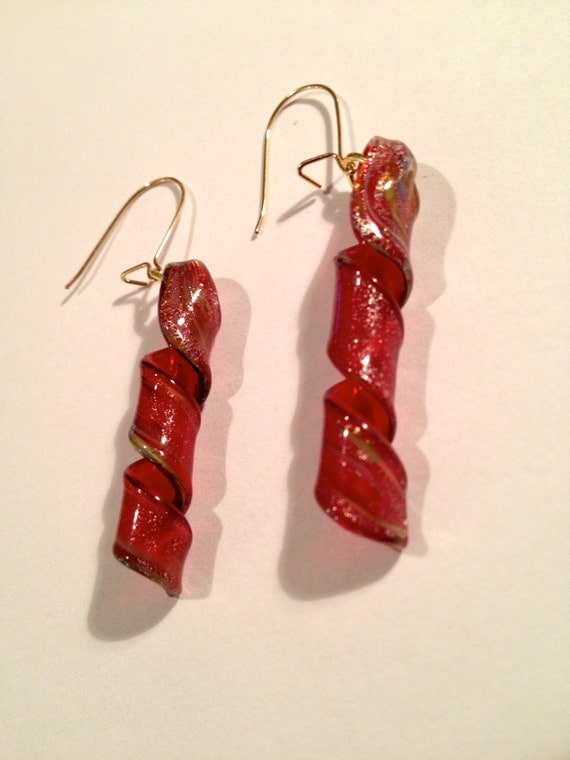 Gold plated earrings with red twirling glass beads with touches of gold and silver twirls