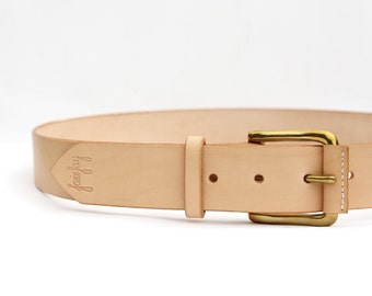 """Handmade leather belt with solid brass buckle. Natural veg tan leather. Size medium,to fit 33"""" to 35"""" waist. 1 1/2"""" wide."""