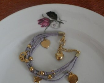 Hand made charm bracelet  purple and gold colors