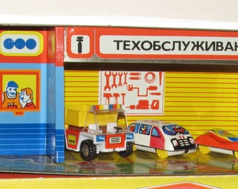 Vintage tin toy garage, gas station 1980's new with box.