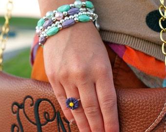 Purple adjustable Daisy ring.