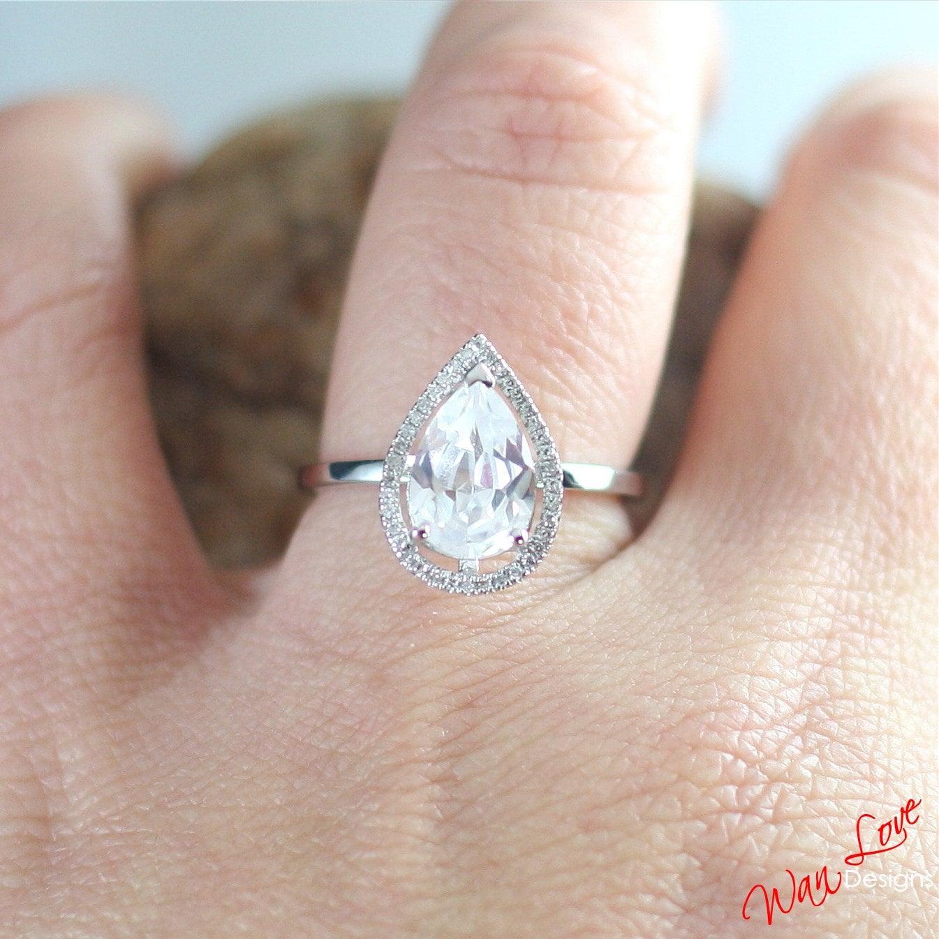 white topaz pear halo engagement ring plain shank