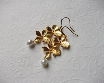 Gold orchid earrings with pearl