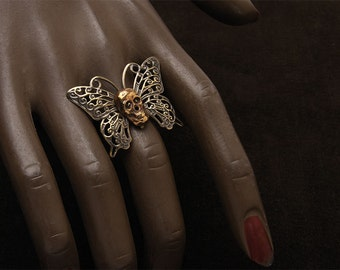 Butterfly and skull ring