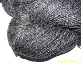 Lt. sport wt. 2 ply Gotland wool yarn  dark gray skeins  to order wrapped and washed prior to shipment. Skein sold by oz.