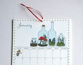 2015 Wall Calendar, 8.5x11 inches featuring 12 different woodland illustrations in blue, red, brown, green, orange and yellow