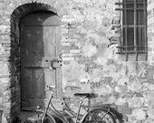 Retro, vintage bicycle by a door, stone wall. Fine Art travel photography, Siena, Florence, Tuscany, Italy. Black and White, home decor.