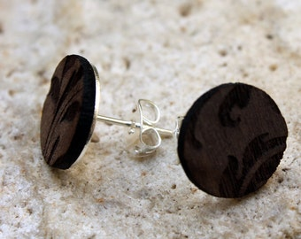 Voltaire 1958. Walnut wood earrings are cut and engraved laser textured Voltaire 1958.