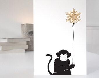 Monkey Christmas Card in a minimalist illustrative style
