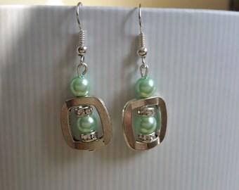 Beautiful collection of light green rhinestone earrings