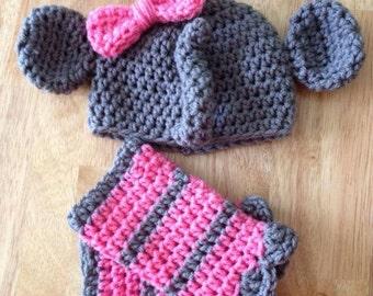 Hand crocheted newborn animal hat and matching leg warmers.
